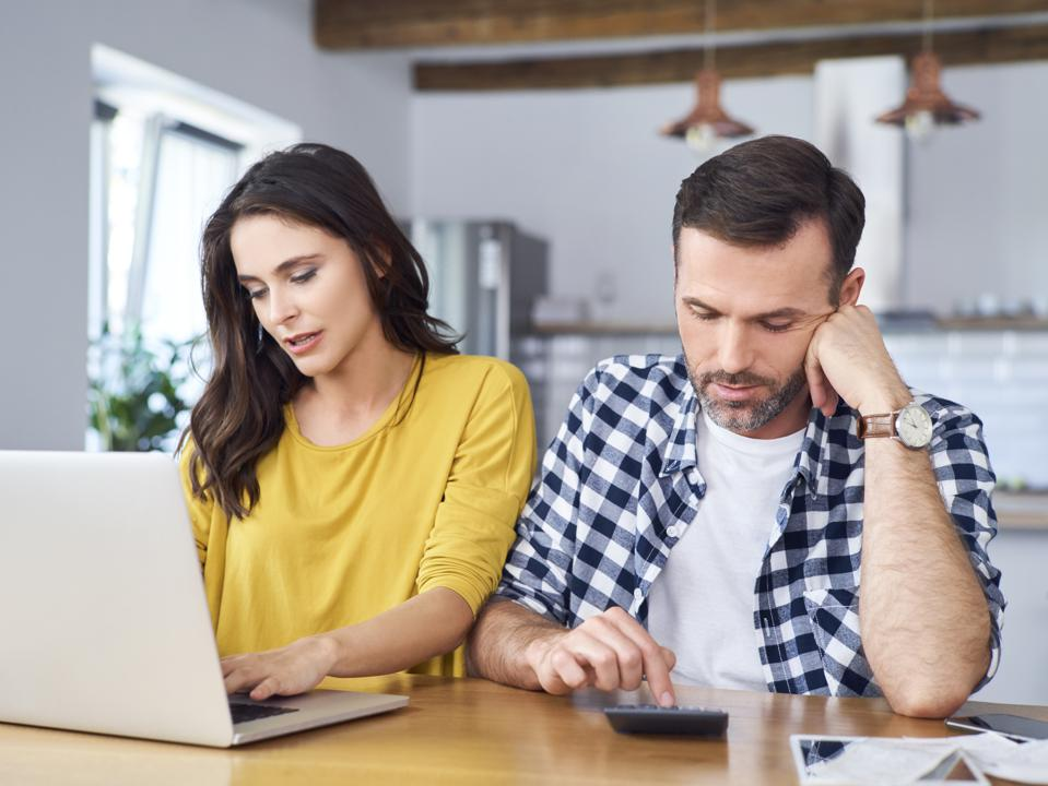 Couple calculating retirement investments