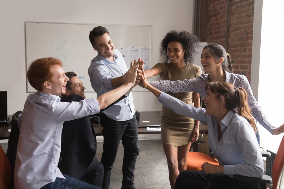 Sales team celebrating a key sale to a client.
