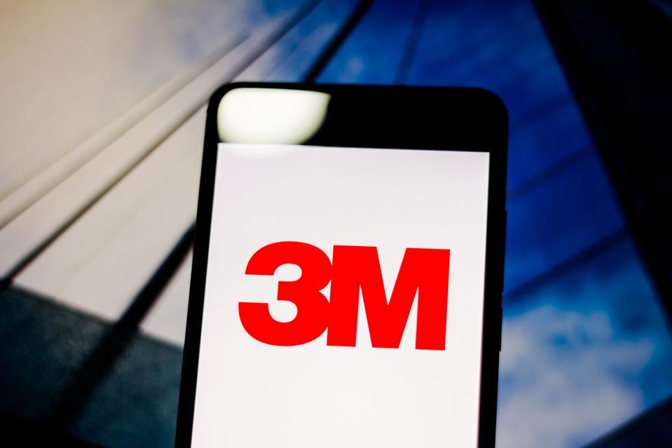 In this photo illustration a 3M Company logo seen displayed...