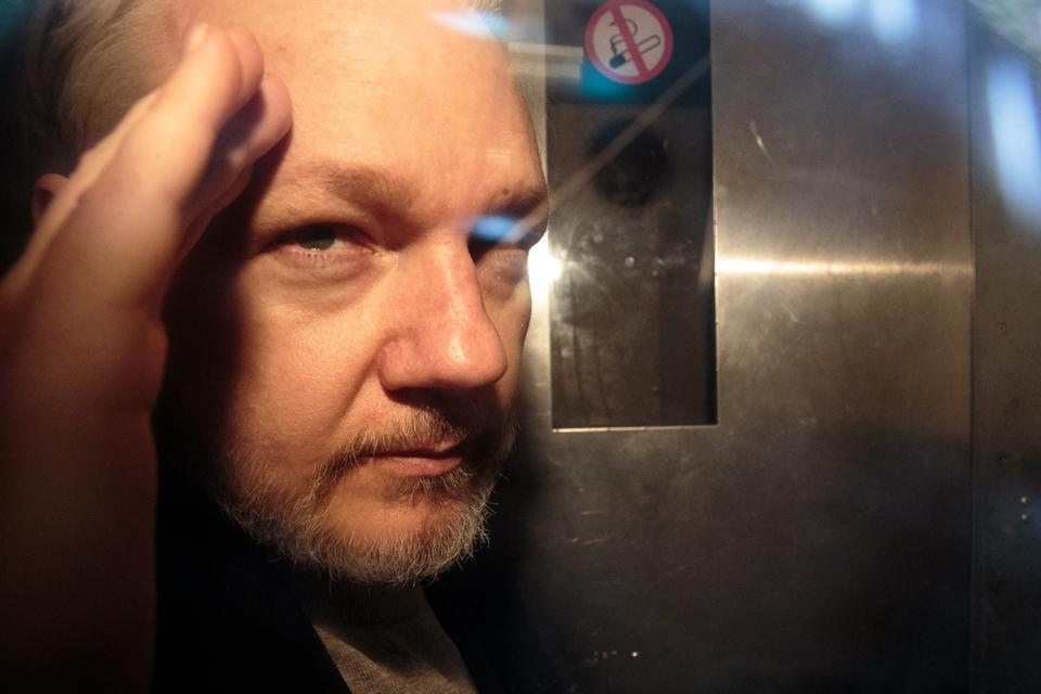 Wikileaks Founder Julian Assange, 47, leaves Southwark Crown Court in a security van after being sentenced on May 1, 2019 in London, England. Assange, was sentenced to 50 weeks in prison for breaching his bail conditions when he took refuge in the Ecuadorian Embassy in 2012 to avoid extradition to Sweden over sexual assault allegations. The U.K. will now decide whether to extradite him to U.S. to face conspiracy charges after his whistle-blowing website Wikileaks published classified US documents. (Photo by Jack Taylor/Getty Images)