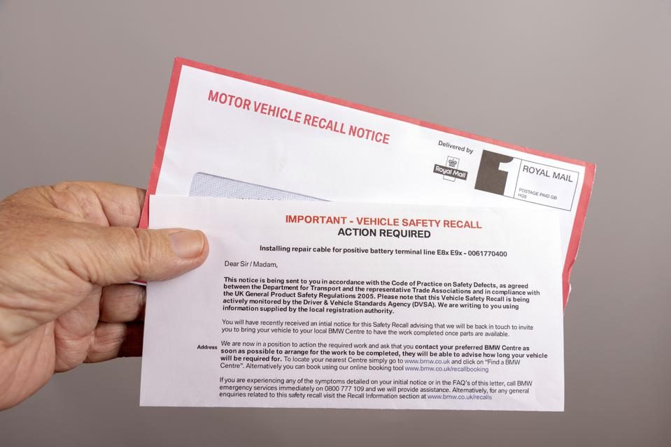 Official notification letter and envelope for a UK car safety recall