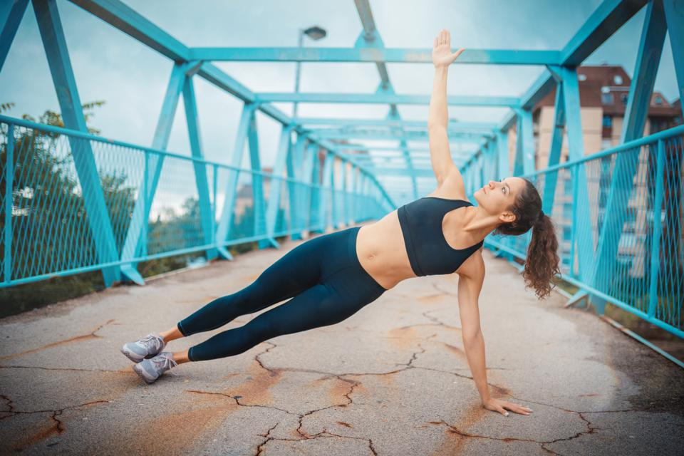 Woman doing side plank pose