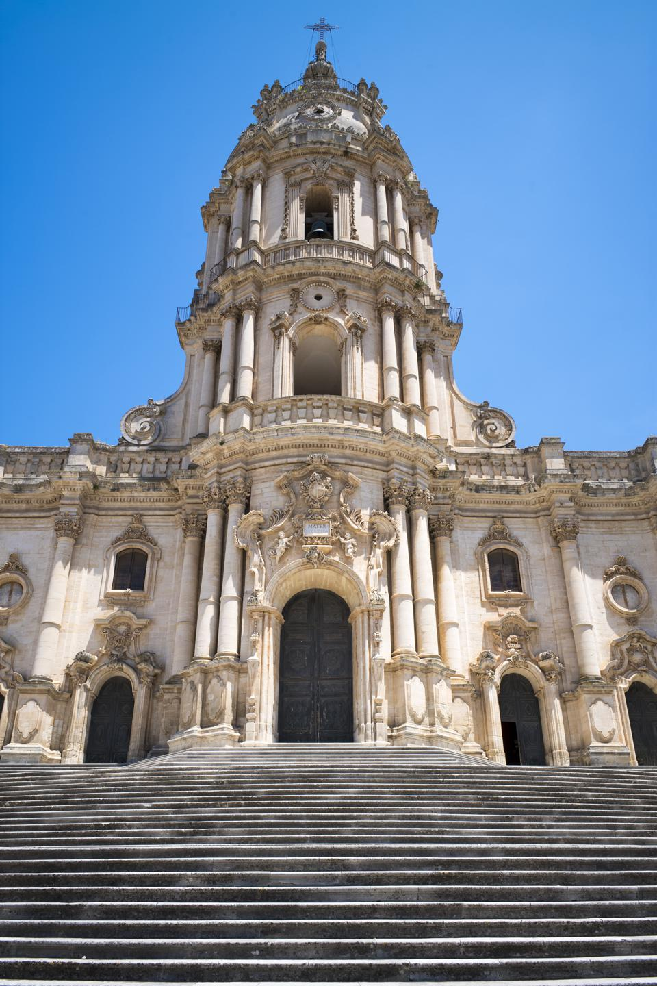 Cathedral of San Giorgio, Modica, Sicily, Italy MODICA ALTA, ITALY:  Entrance elevation and tower of of Baroque style Cathedral of San Giorgio in Modica Alta ragged city, South East Sicily