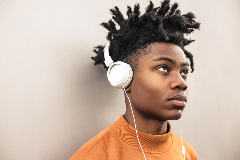 Cool guy listening music with the headphones
