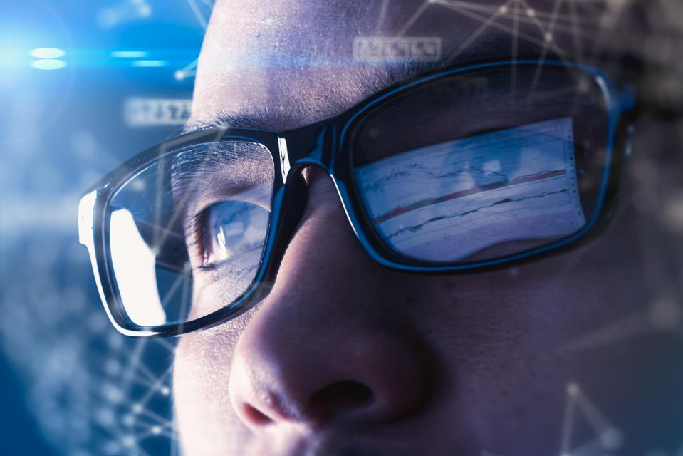 Businessman wear a smart glasses overlay with futuristic hologram