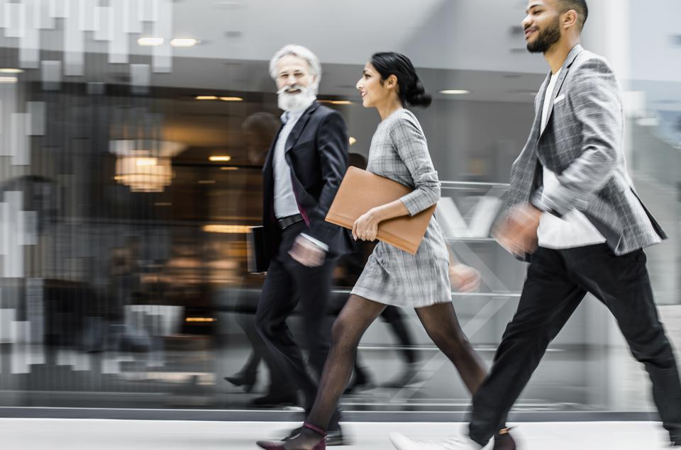 Business people walking across the lobby