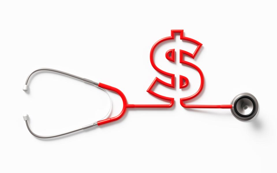 Red Stethoscope Forming An American Dollar Sign On White Background