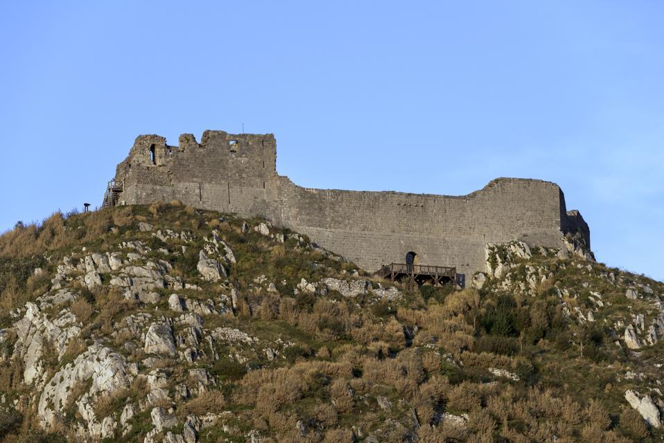 Ruins of the medieval Chateau de Montsegur castle on hilltop.