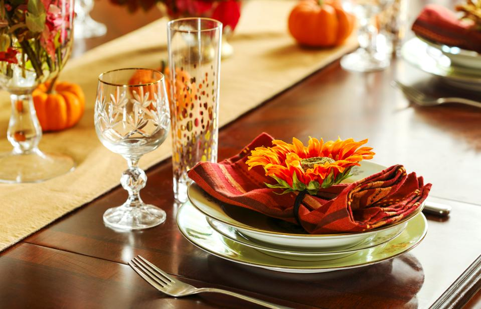 Thanksgiving table setting. Autumn table setting with small pumpkins