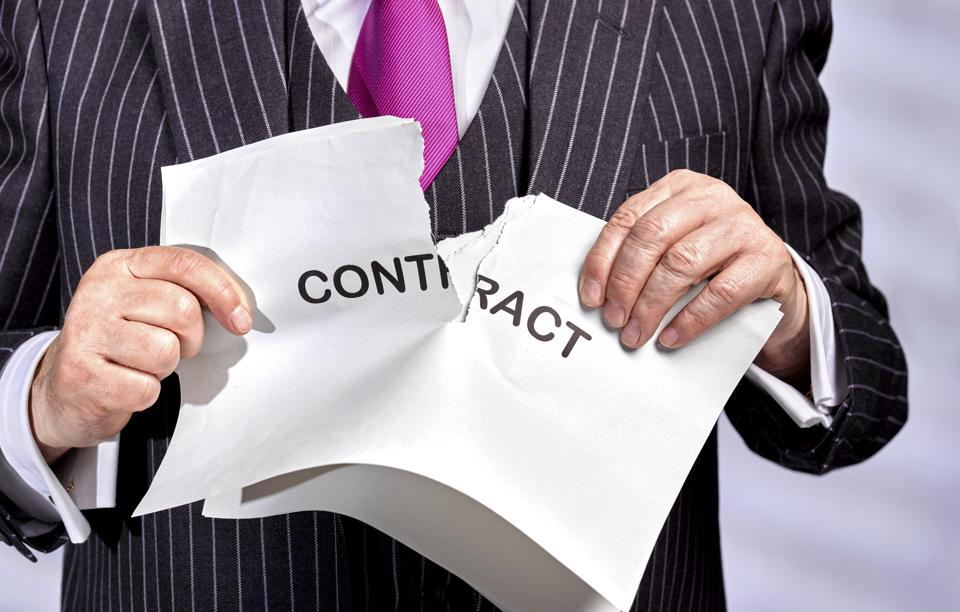 Businessman ripping up contract