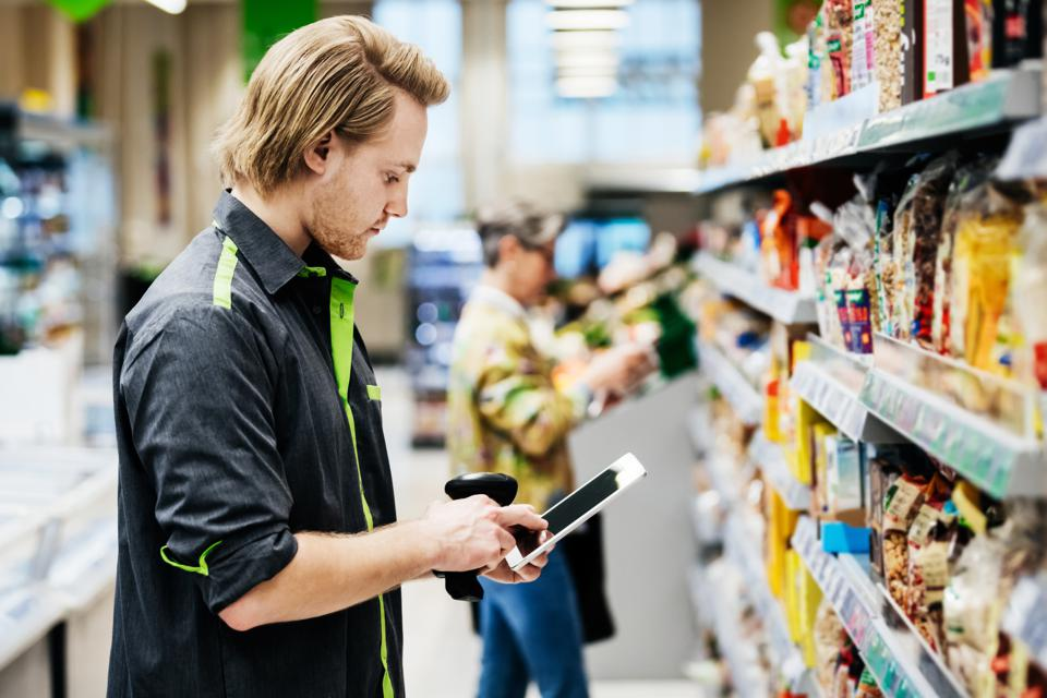 Supermarket Employee Performing Stock Check