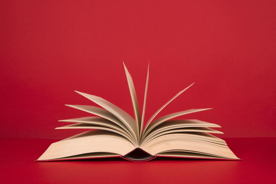 Open book with pages on a red background
