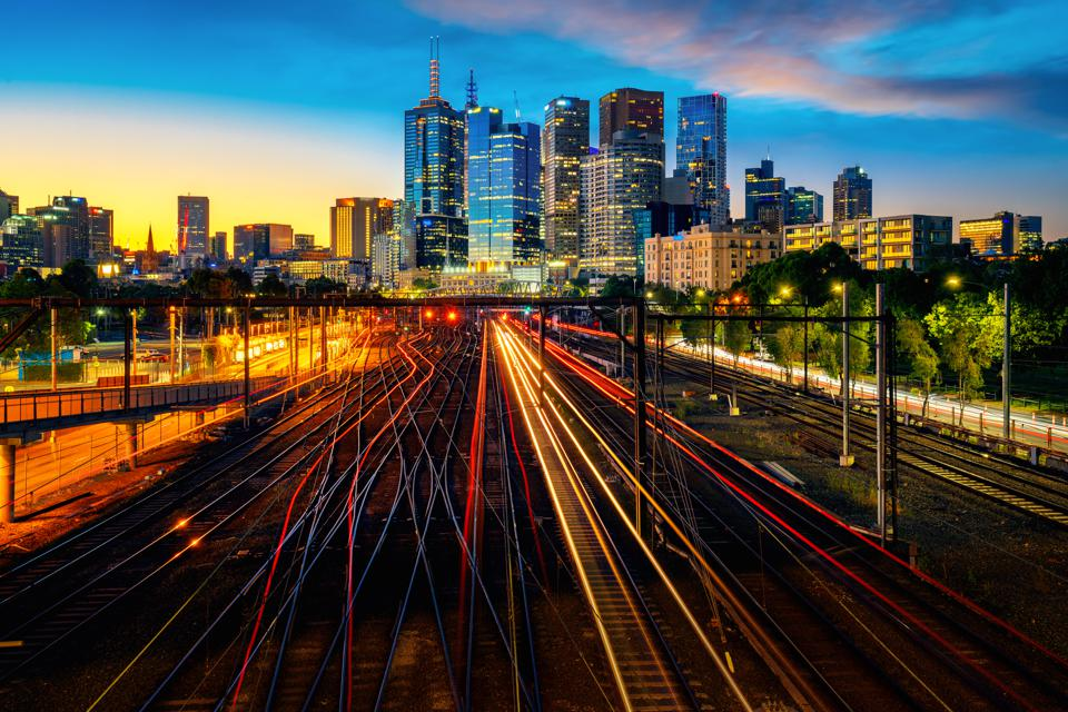 Melbourne train staation with Melbourne city background. It's one of the best places to visit.