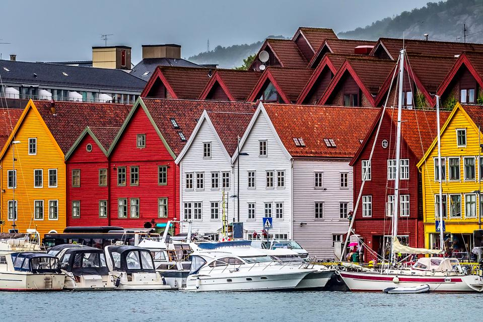 Bergen, Norway: View of Bryggen harbour, boats and colorful traditional Nordic houses