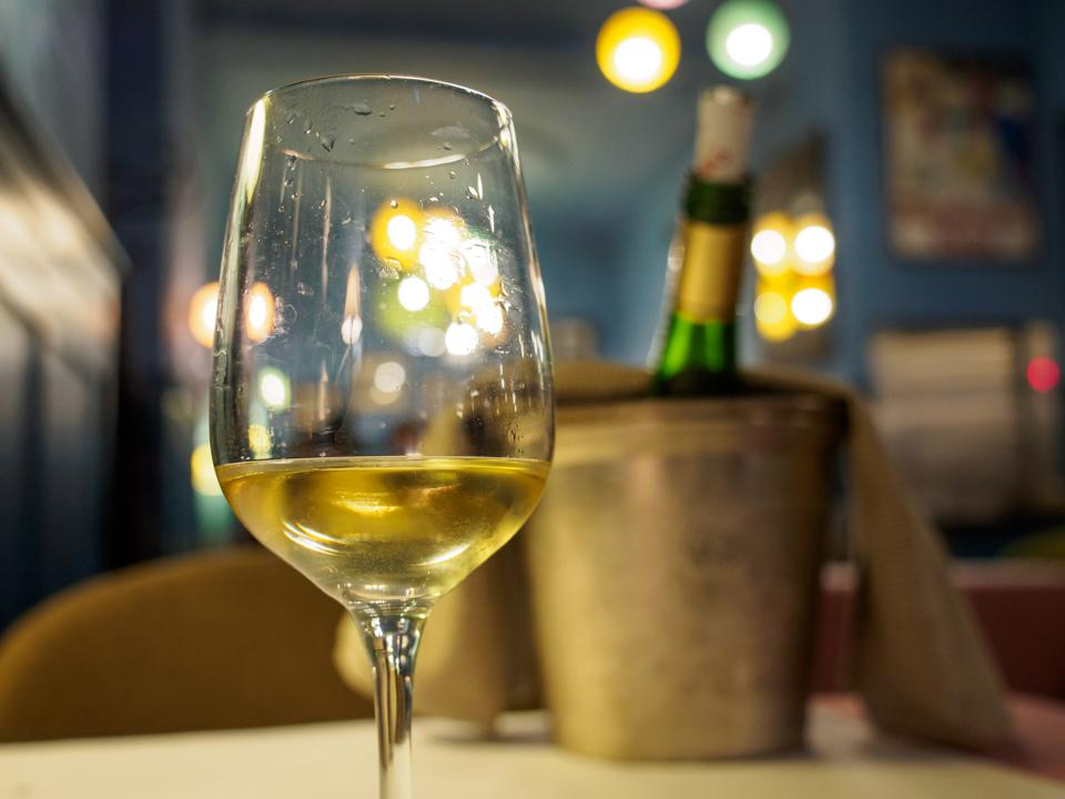 Glass of riesling white wine at restaurant, Colmar, France