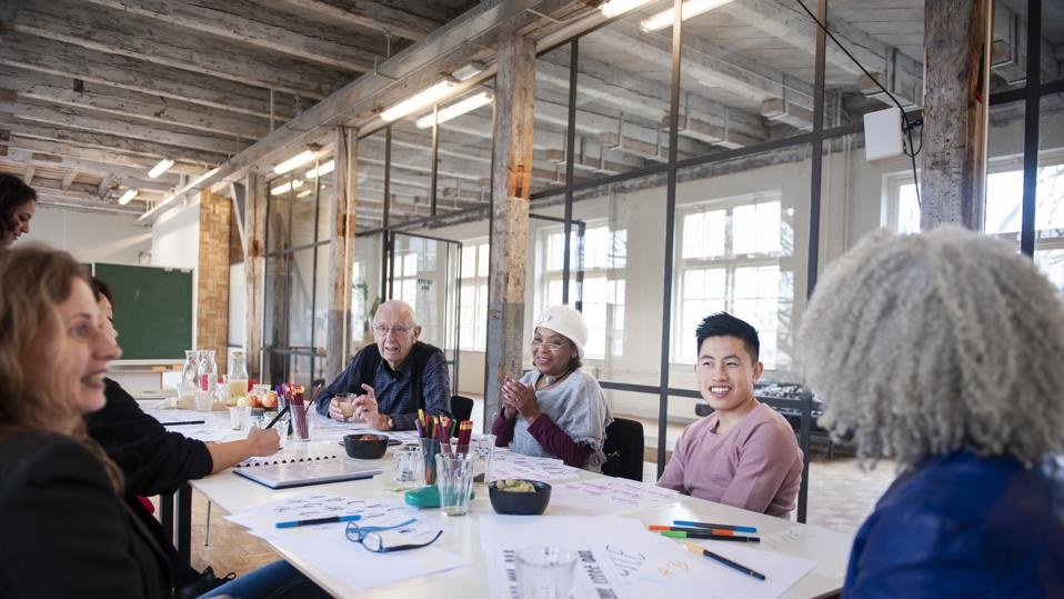 Mixed business team discussing during a creative workshop