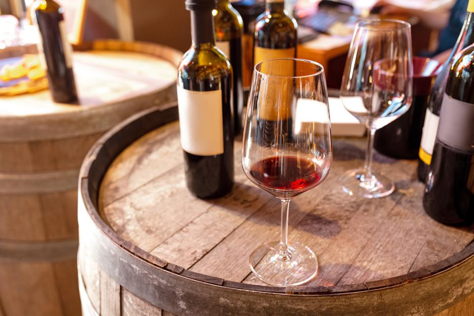Tasting red wine in winery shop