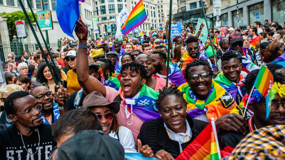 A group of black people are seen shouting slogans while...