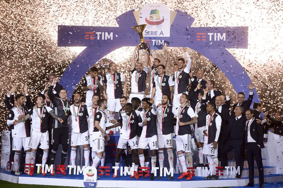 Juventus FC players celebrate with the trophy after winning...