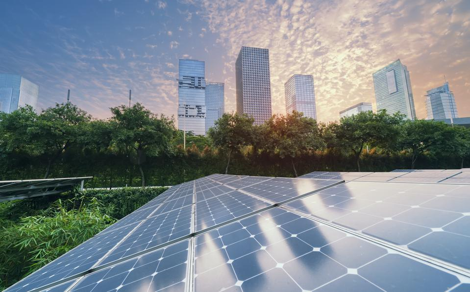 Solar Power Plant in modern city in sunset,Sustainable Renewable Energy