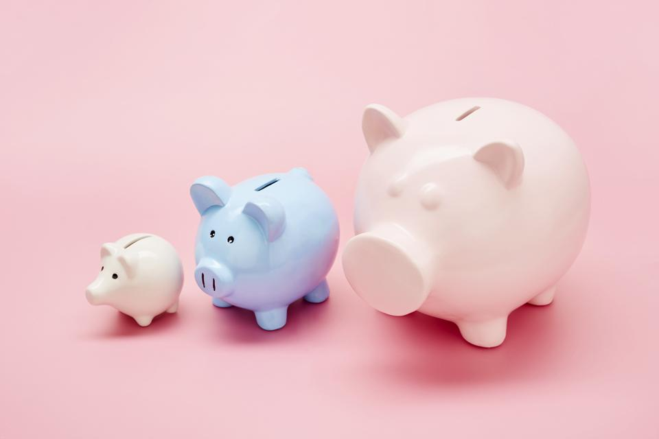 white, blue and pink piggy banks