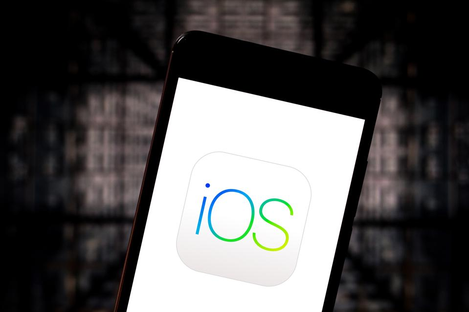 In this photo illustration the iOS logo is seen displayed on...