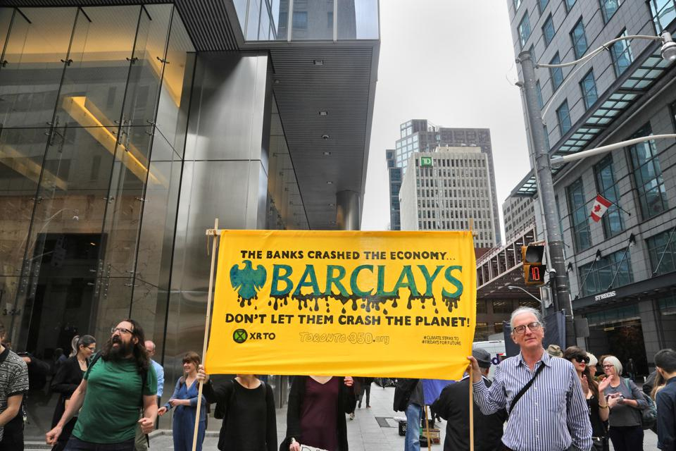 Activists from Extinction Rebellion Toronto and other environmental groups in Toronto, Canada  call for Barclays to stop funding new fossil fuel projects. So far there have not been protests targeting foundations. (Photo by Creative Touch Imaging Ltd./NurPhoto via Getty Images)