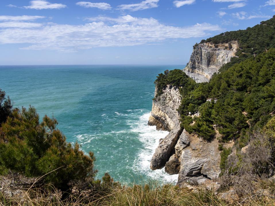 Dramatic Mediterranean cliffs and coastline on Palmaria Island, just off Portovenere in La Spezia province, Liguria, Italy.