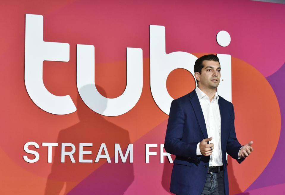 """The Bachelor"" Talent Attends Tubi NewFront Event Tubi CEO Farhad Massoudi onstage"
