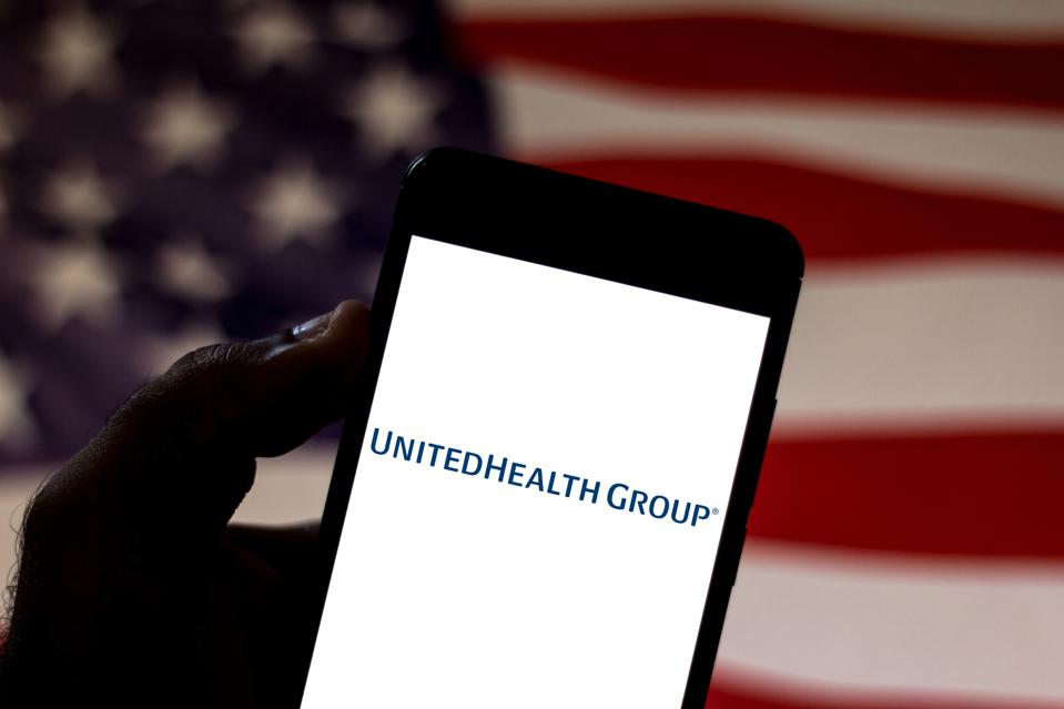 In this photo illustration the UnitedHealth Group logo is...