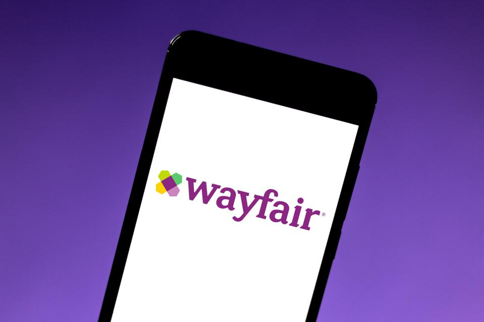 In this photo illustration the Wayfair logo is seen...