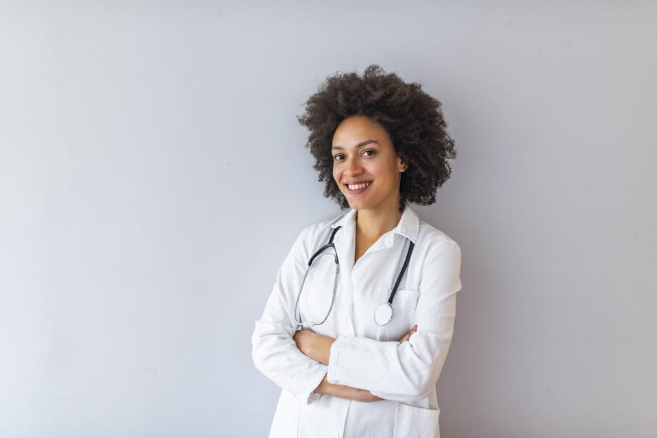 Woman hospital worker looking at camera and smiling