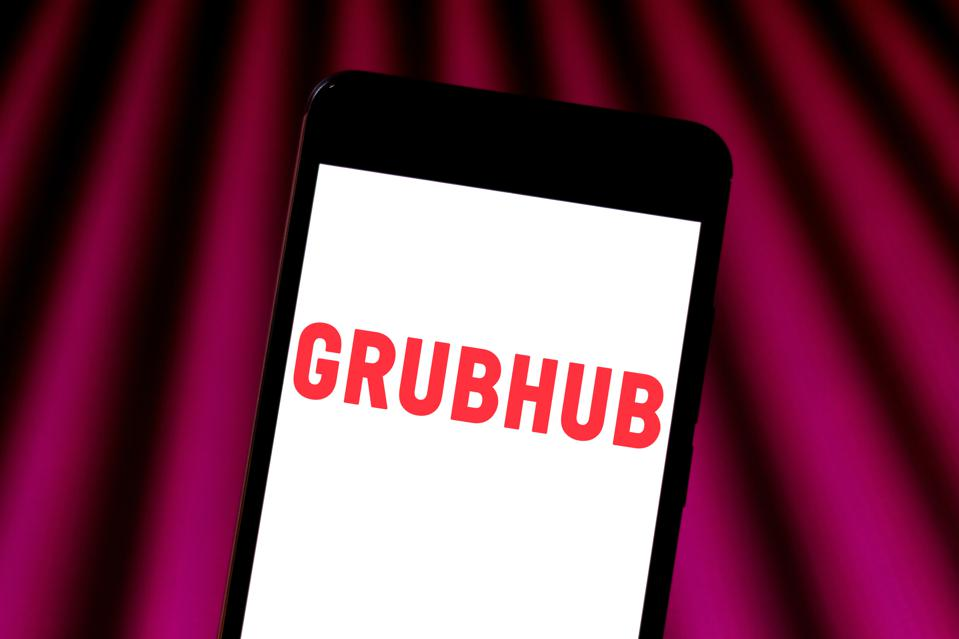 In this photo illustration a Grubhub logo seen displayed on...