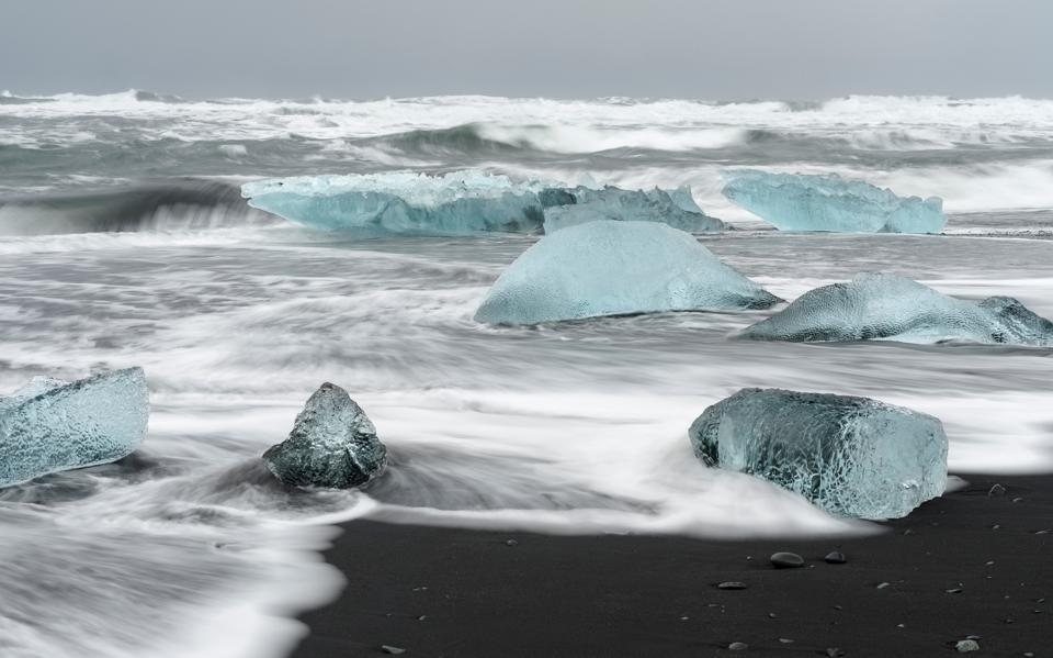 Icebergs on black volcanic beach. Beach of the north atlantic near the glacial lagoon Joekulsarlon and glacier Breithamerkurjoekull in the Vatnajoekull NP.europe. northern europe. iceland. February