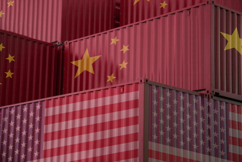 Cargo containers with China and united States flag in the harbor.