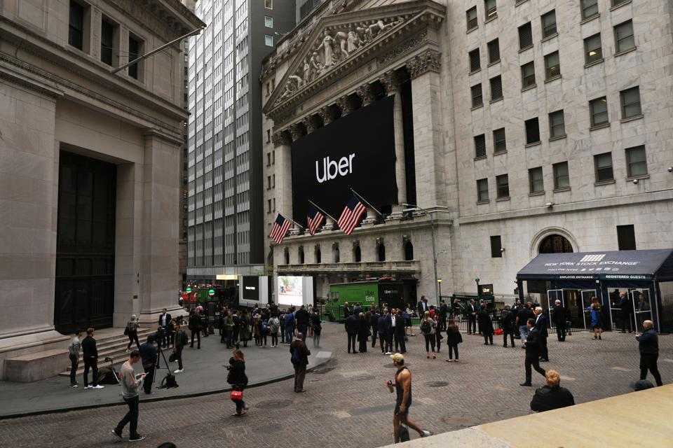 An uber sign hanging over the columns at the New York Stock Exchange.
