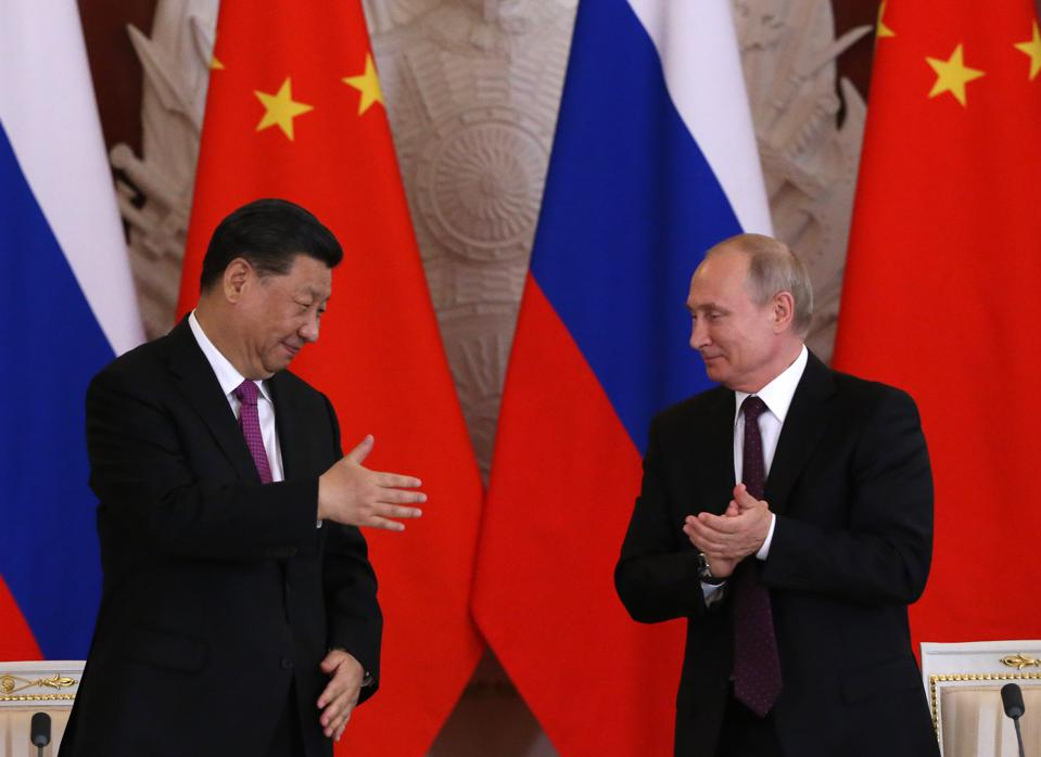 Putin Moves Closer To China As New 'Technological War' With U.S. Intensifies