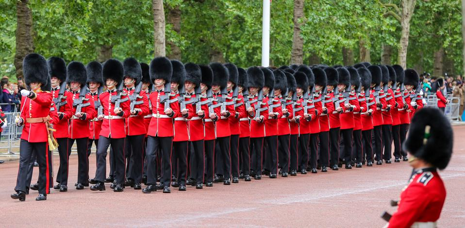 Cold-stream Guards march to the Horse Guards Parade during...