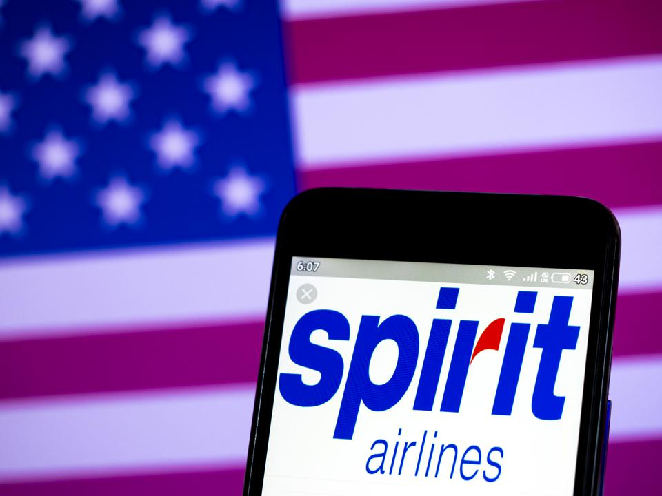 In this photo illustration the Spirit Airlines logo is seen...