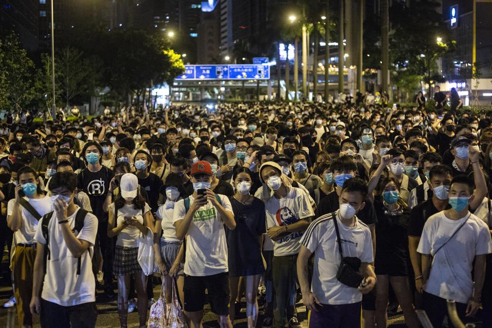 Demonstrators seen occupying a section of a main road in Wan...
