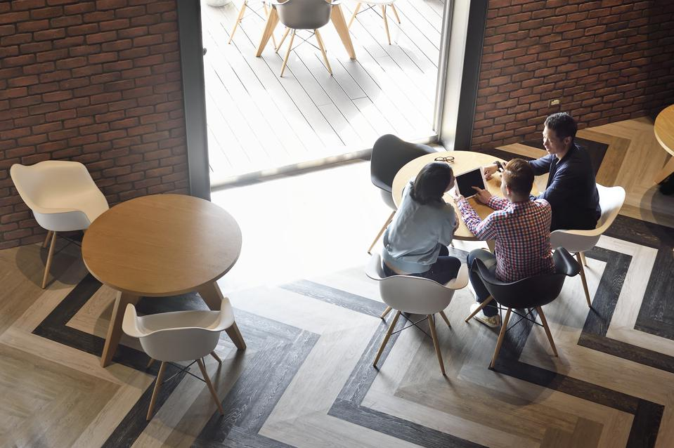 Overhead view of creatives working together in a co-working space