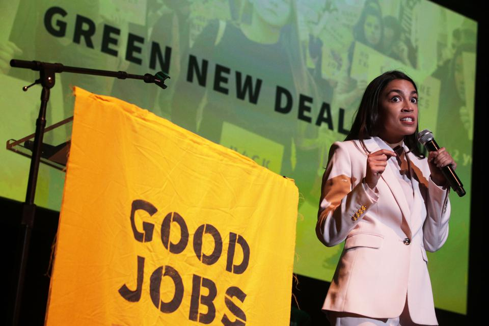 Alexandria Ocasio-Cortez  And Bernie Sanders Attend Green New Deal Rally At Howard University