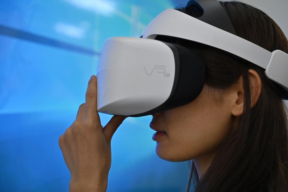 A woman checks a Huawei 3D Virtual Reality headset.