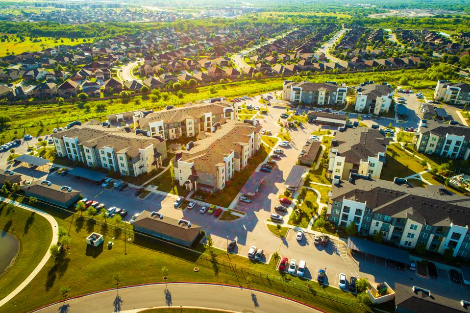 Golden Sunrise over Apartments and Suburbs in Austin Texas aerial drone view