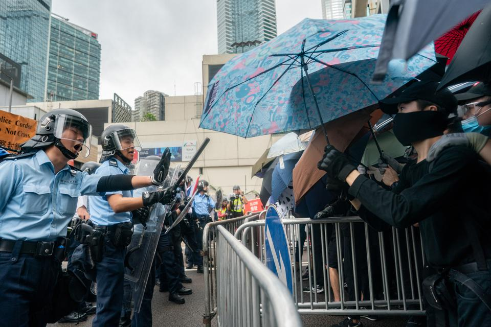 Protestors use umbrellas to protect themselves from tear gas and pepper spray.