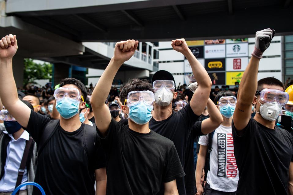 Protesters chant slogans outside the Legislative Council in Hong Kong.