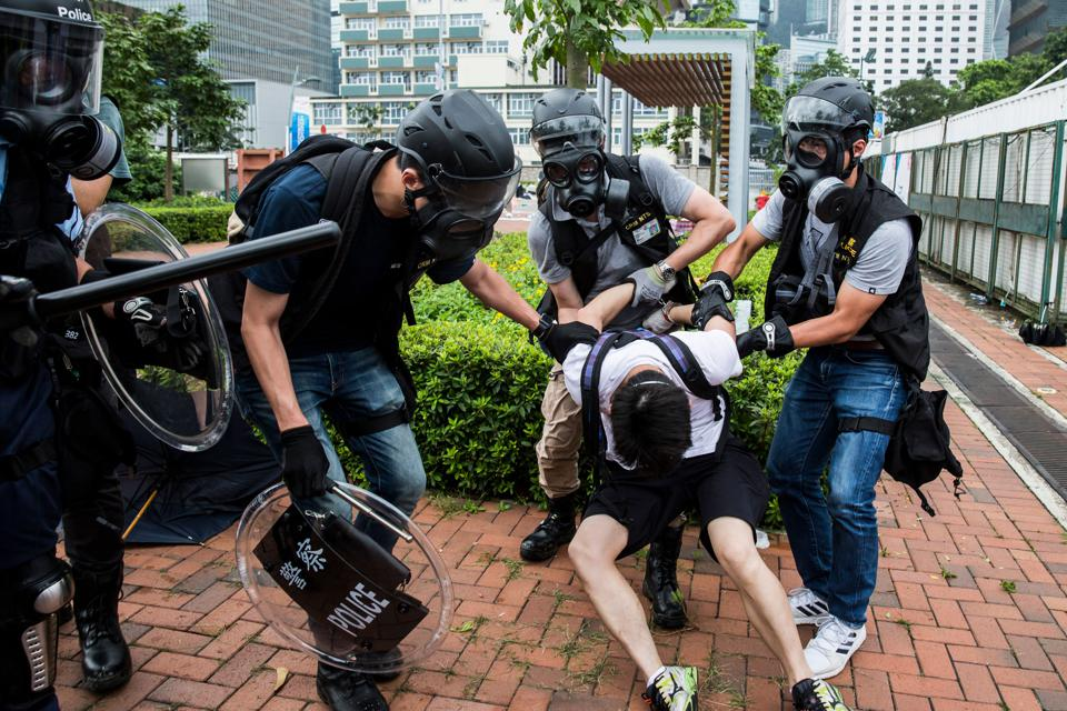Police arrest a man during Wednesday's protests.
