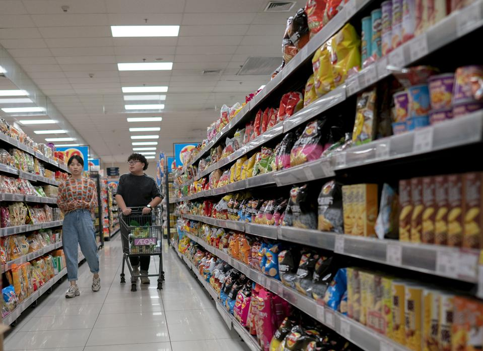 People are shopping snacks in a supermarket.  The National...