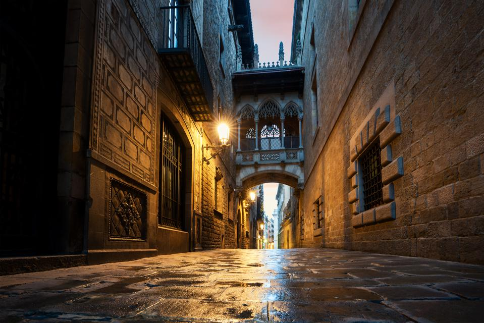 Barri Gothic Quarter And Bridge Of Sighs At Night In Barcelona