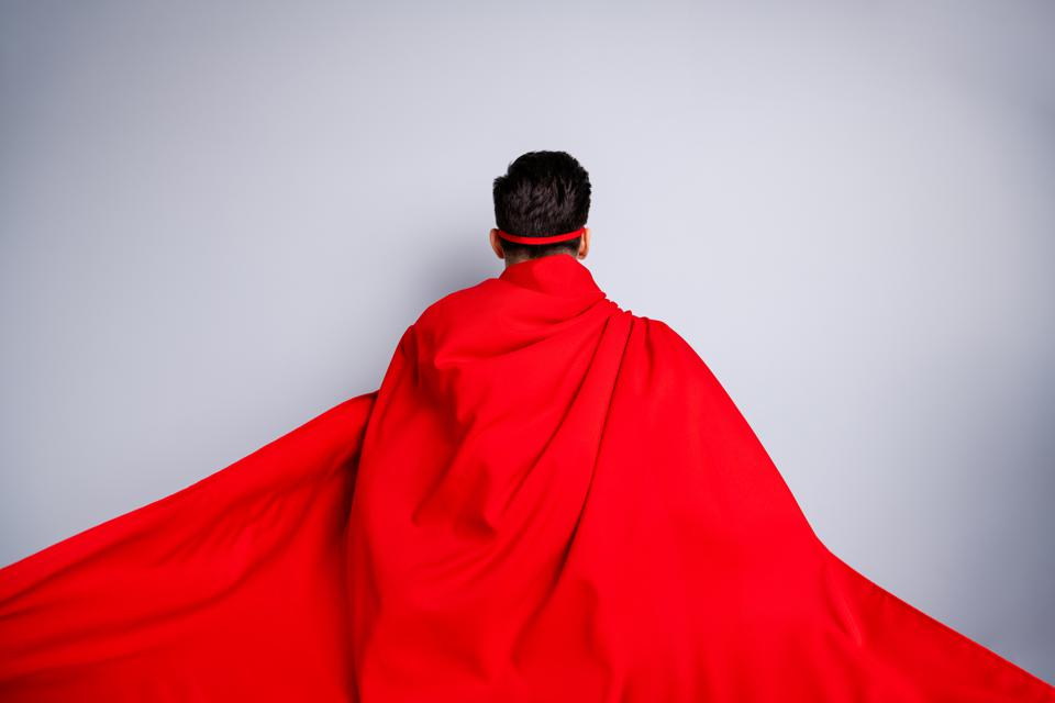 Close up back rear behind view photo hiding facial expression he him his man ready flight use superpower wear red long cloak raised wind safety protection human race concept isolated grey background